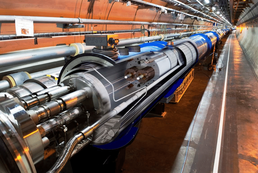 LHC tunnel with an artistic cut through a LHC dipole magnet highlighting the.ppm